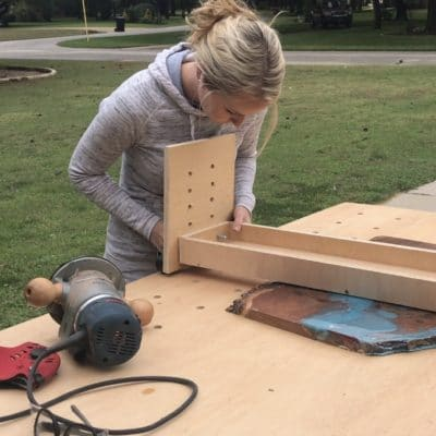 Install bolts to legs for router sled